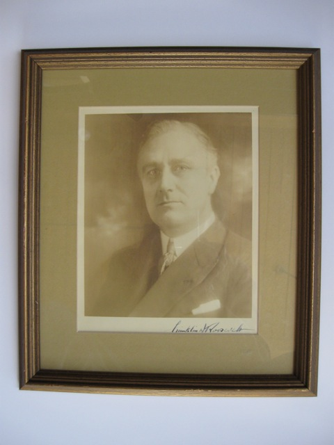 Portrait photograph of Franklin Delano Roosevelt, 32nd President of the United States (1933-1945), as Governor of New York (1929-1932), showing him looking straight ahead, slightly over his left shoulder, in suit jacket and silk tie, pocket handkerchief showing, his bold signature in the lower margin. Franklin Delano Roosevelt, Louis Fabian 32nd President of the United States Bachrach, Sr.